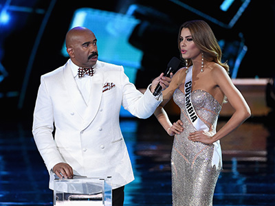 LAS VEGAS, NV - DECEMBER 20: Host Steve Harvey (L) listens as Miss Colombia 2015, Ariadna Gutierrez Arevalo, answers a question during the interview portion of the 2015 Miss Universe Pageant at The Axis at Planet Hollywood Resort & Casino on December 20, 2015 in Las Vegas, Nevada. (Photo by Ethan Miller/Getty Images)