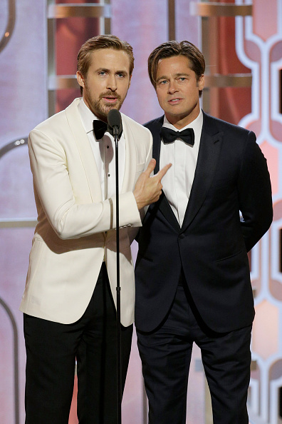 Ryan Gosling and Brad Pitt present an award together. Photo: Getty