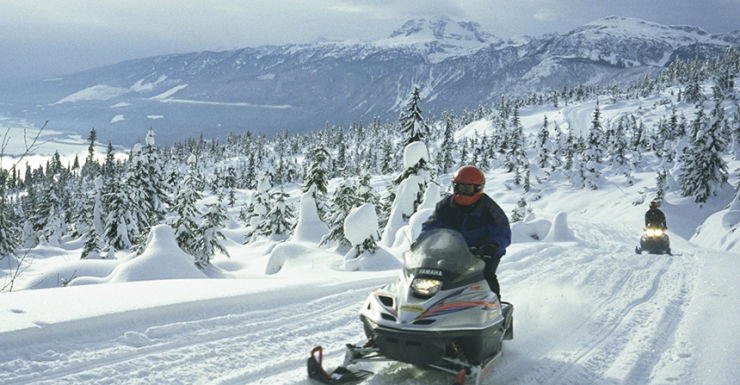 Canadia Rocky Mountains snow mobile Getty