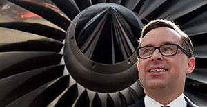 CORRECTION Qantas chief executive Alan Joyce poses for photos after a press conference in Sydney on August 20, 2015. Australia carrier Qantas roared back into the black in a stunning turnaround of fortunes driven by aggressive cost-cutting, while placing an order for eight Boeing Dreamliners. AFP PHOTO / SAEED KHAN (Photo credit should read SAEED KHAN/AFP/Getty Images)
