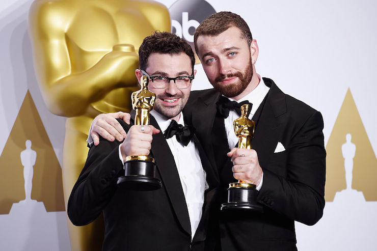 Songwriter Jimmy Napes (L) and singer-songwriter Sam Smith with their award for 'Writing's on the Wall'.