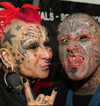 Two eyeball tattoo recipients at a festival in Brazil.