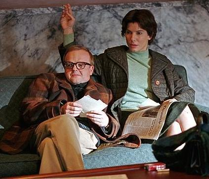 Toby Jones as Truman Capote and Sandra Bullock as Harper Lee in the film Infamous.
