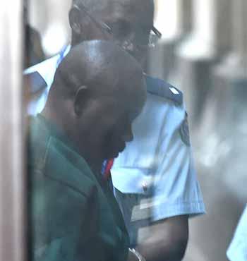 Belenga Kalala arrives at the Supreme Court for sentencing in December, 2015.