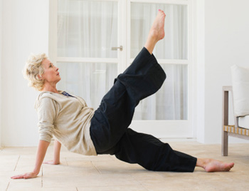 Pilates is low impact and great for the all-important pelvic floor. Photo: Getty