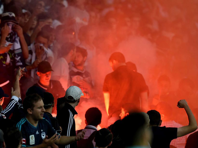 victory fans let off flare