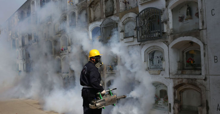 A health worker fumigates to prevent the virus spreading in Peru.