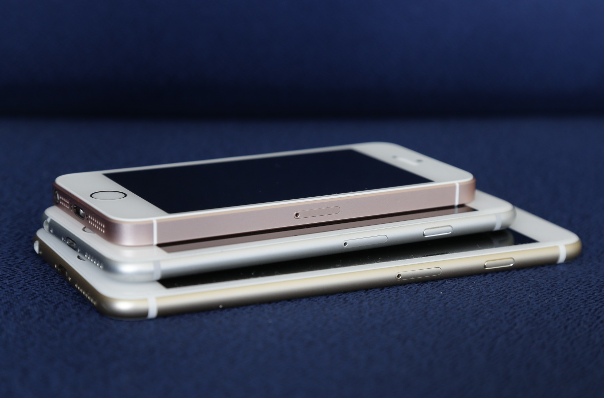 From bottom to top: the iPhone 6S plus, 6S and SE. Photo: AP