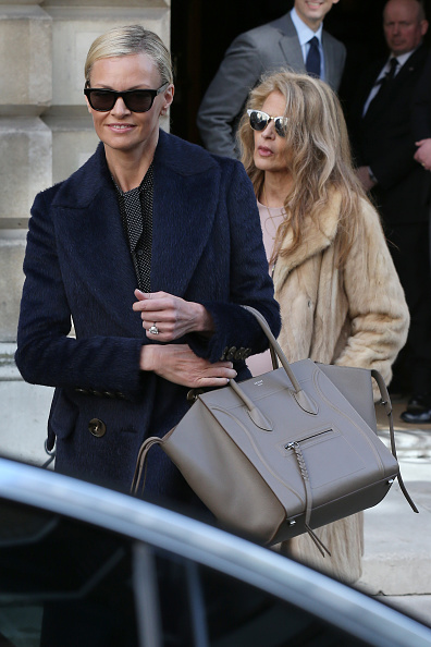Sarah Murdoch leaves Spencer House followed by