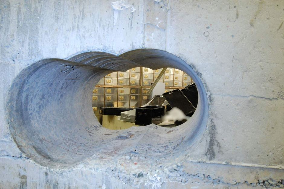 The hole the men bored to access the vault. Photo: Metropolitan Police
