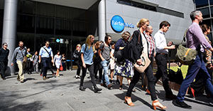 Editorial staff are seen walking out of Fairfax Media headquarters in Sydney, Thursday, March 17, 2016. The company announced today 120 editorial positions would be cut, and in response staff voted to walk off the job until Monday. (AAP Image/Dan Himbrechts) NO ARCHIVING