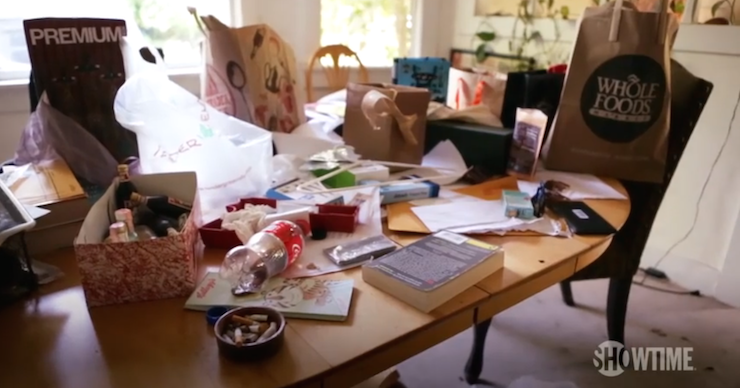 Rousey's living room table features shopping bags, coke bottles and cigarette butts.