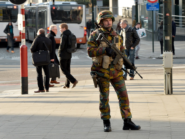 A soldier secures the perimeter in front of Grand Central Station in Brussels.