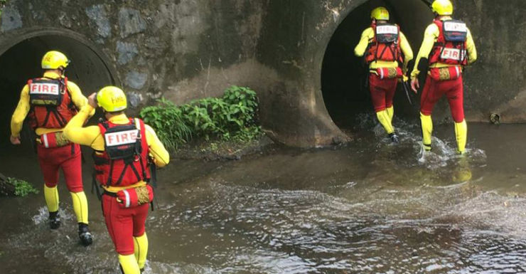 Fire crews enter a storm drain during the search.
