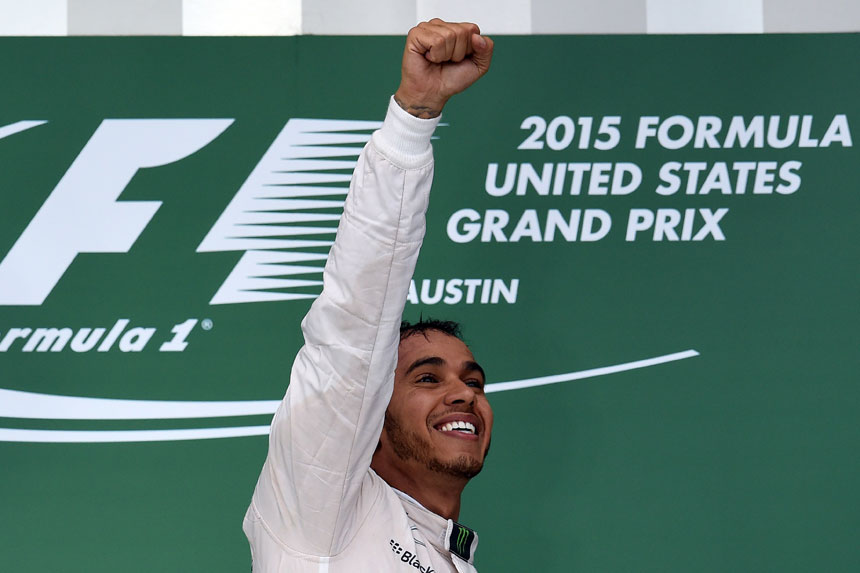 Hamilton celebrates his third world title last year. Photo: Getty