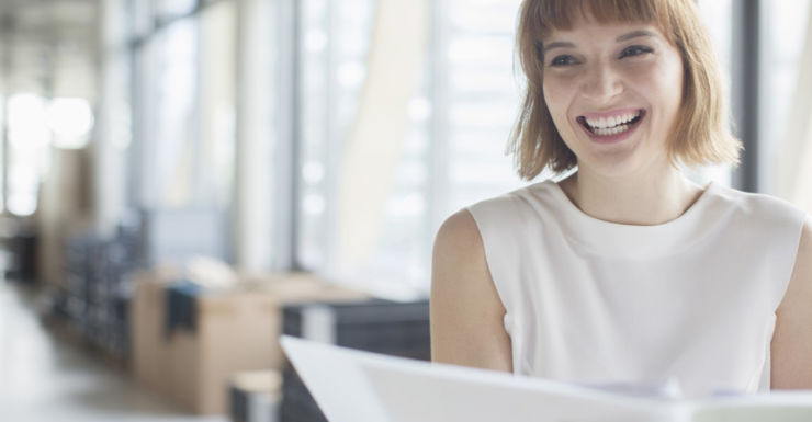 Happy woman smiling at her desk