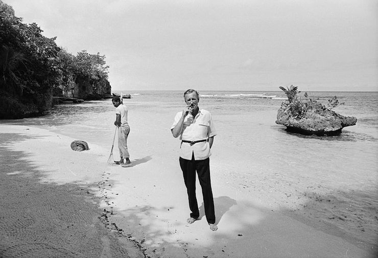 Ian Fleming on the beach at Goldeneye in 1964. Photo: Getty
