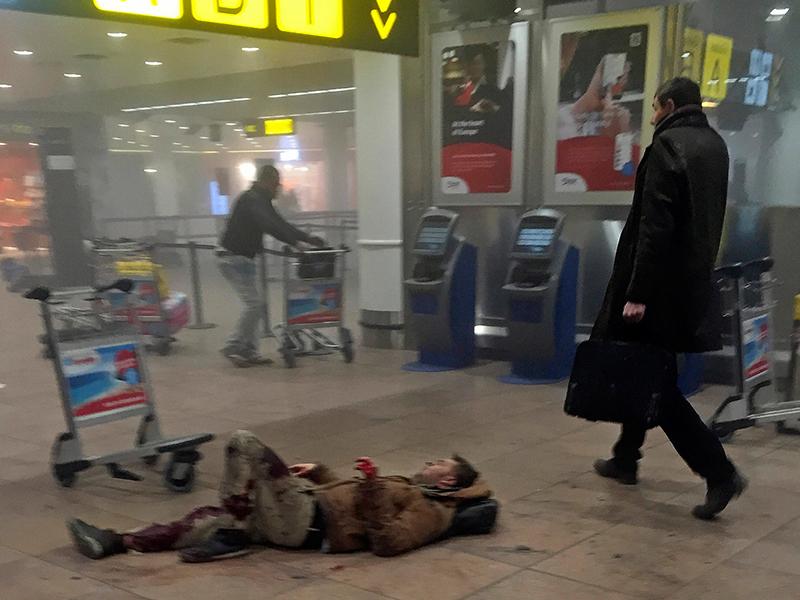 A man lies injured in Zaventern Airport. Photo: AP