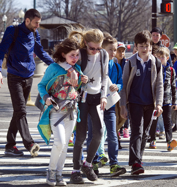 Children are escorted away from Capitol Hill in Washington.