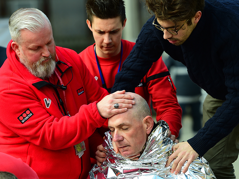 A victim receives first aid near Maalbeek metro station. Photo: Getty