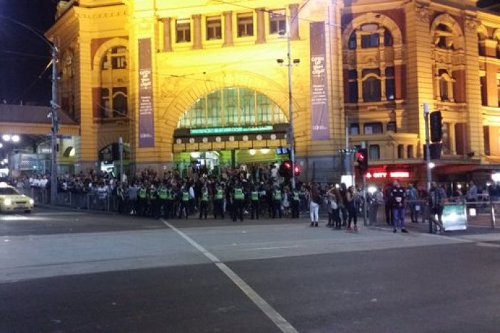 Police patrol Flinders St station amid violent clashes in the city. Photo: Twitter