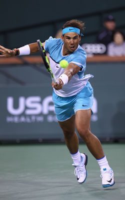 Nadal returns a ball during his three-set win over Muller. Photo: Getty