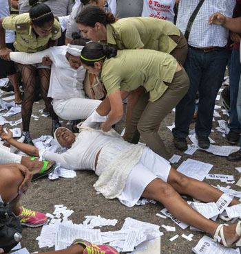 Members of the Ladies in White group are arrested during their protest in Havana.