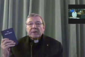 Cardinal Pell swears on the bible before giving evidence at the royal commission. Photo: ABC