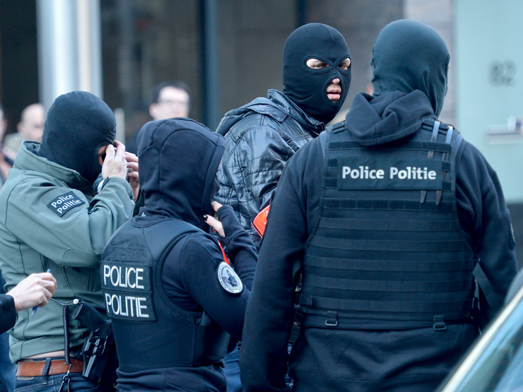 Belgian police search for a suspect.