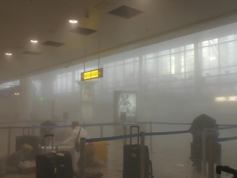 Travellers make their way through the smoke-filled Zaventern Airport. Photo: AP