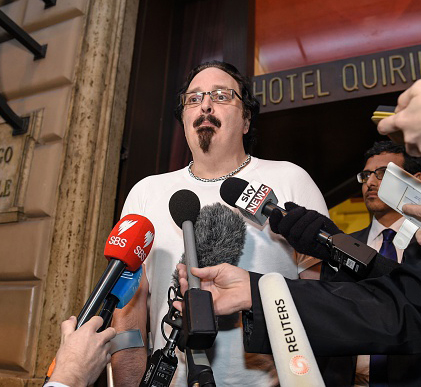 Survivor Stephen Woods, abused by Father Risdale, addresses reporter outside the hearing. Photo: Getty