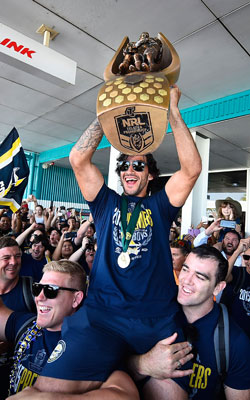 The King of Townsville: Johnathan Thurston celebrates last year's grand final triumph. Photo: Getty