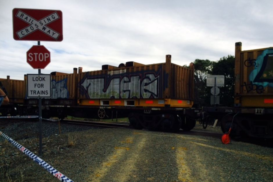 A freight train thunders through the level crossing where the lives of a mother and her three daughters changed forever.