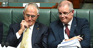 Prime Minister Malcolm Turnbull (L) and Treasurer Scott Morrison during Question Time at Parliament House in Canberra on Wednesday, March 16, 2016. (AAP Image/Mick Tsikas) NO ARCHIVING