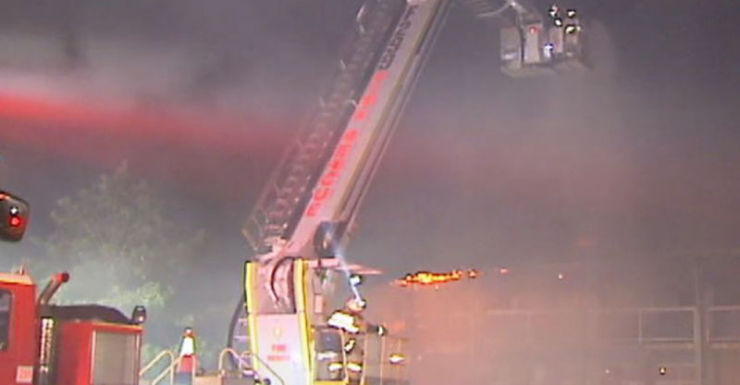 Firefighters used a cherry picker to bring the fire under control.