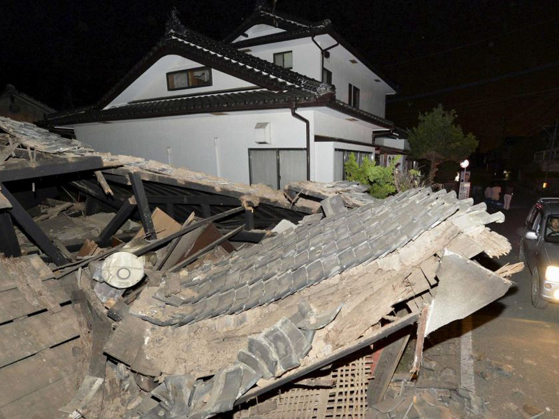 A collapsed house is seen after an earthquake in Kumamoto.