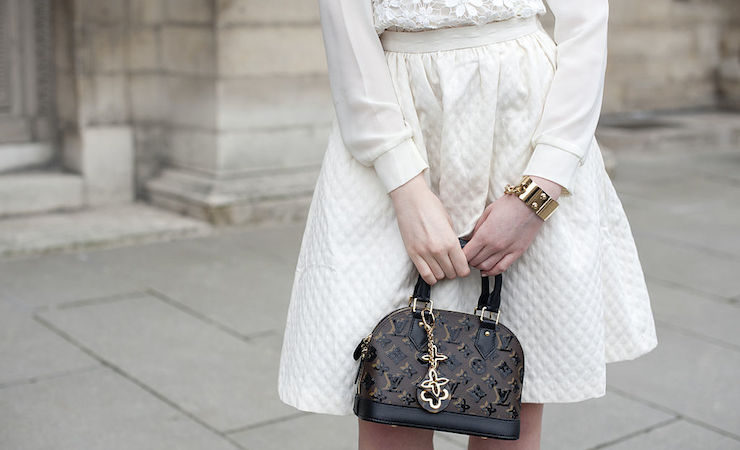 On real designer handbags, the logos rarely disappear into the seams. Photo: Getty