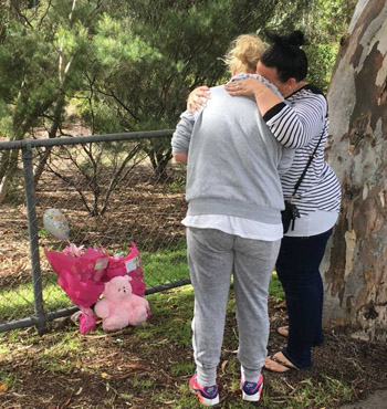 West Heidelberg residents Michelle and Faye leave a floral tribute for toddler Sanaya Sahib.