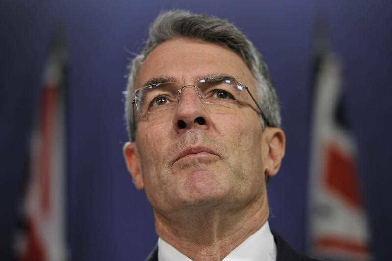 Mr Dreyfus has repeated calls for Mr Brandis to resign. Photo: AAP.