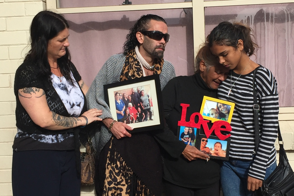 Grieving mother Donna Rigney (2nd right) comforted by other family members in Adelaide