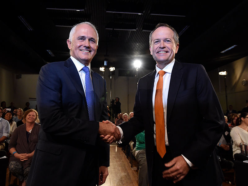 Leader of the Opposition Bill Shorten and Prime Minister Malcolm Turnbull shake hands before a Leaders Forum at Windsor RSL as part of the 2016 election campaign in Sydney, Friday, May 13, 2016. (AAP Image/Mick Tsikas) NO ARCHIVING