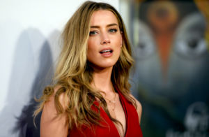 amber heard sues producer over sex scene