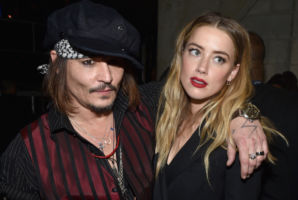 Johnny Depp and Amber Heard are pictured at the 58th GRAMMY Awards in February last year