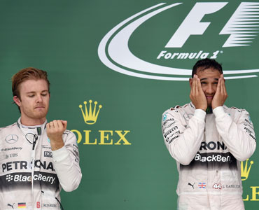 Rosberg (L) watched on as Hamilton was given the 2015 world title. Photo: Getty