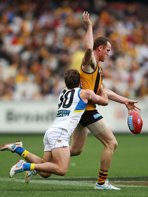 Brown tackles Roughead as a Gold Coast player. Photo: Getty