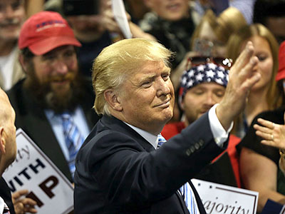 BILLINGS, MT - MAY 26: Republican presidential candidate Donald Trump signs autographs after giving a speech at a rally on May 26, 2016 in Billings, Montana. According to a delegate count released Thursday, Trump has reached the number of delegates needed to win the GOP presidential nomination. (Photo by Spencer Platt/Getty Images)