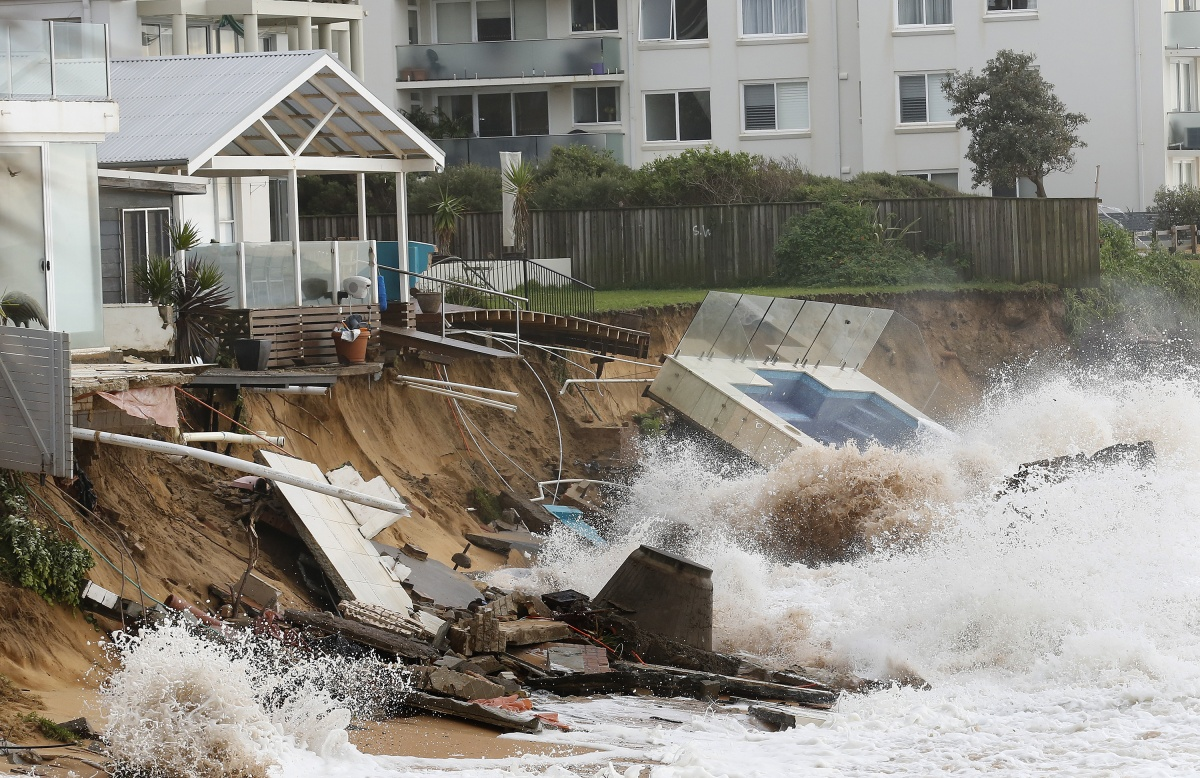 Evacuated houses are hit by big waves after torrential rains on Sydney's northern beaches.