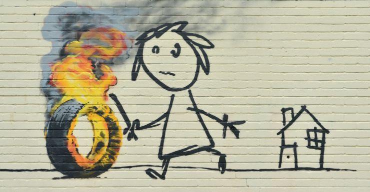 The Banksy mural at the Bristol school.