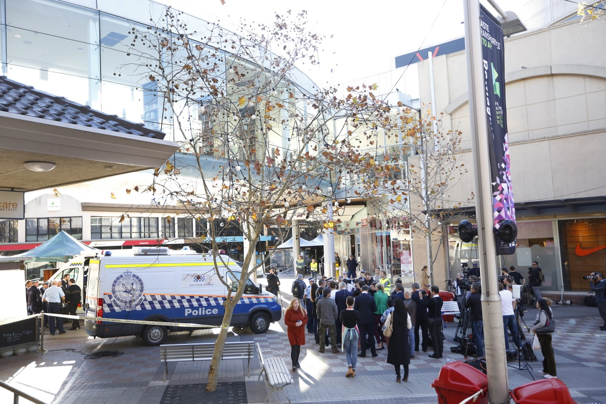 Four people wounded in Hornsby market police shooting.