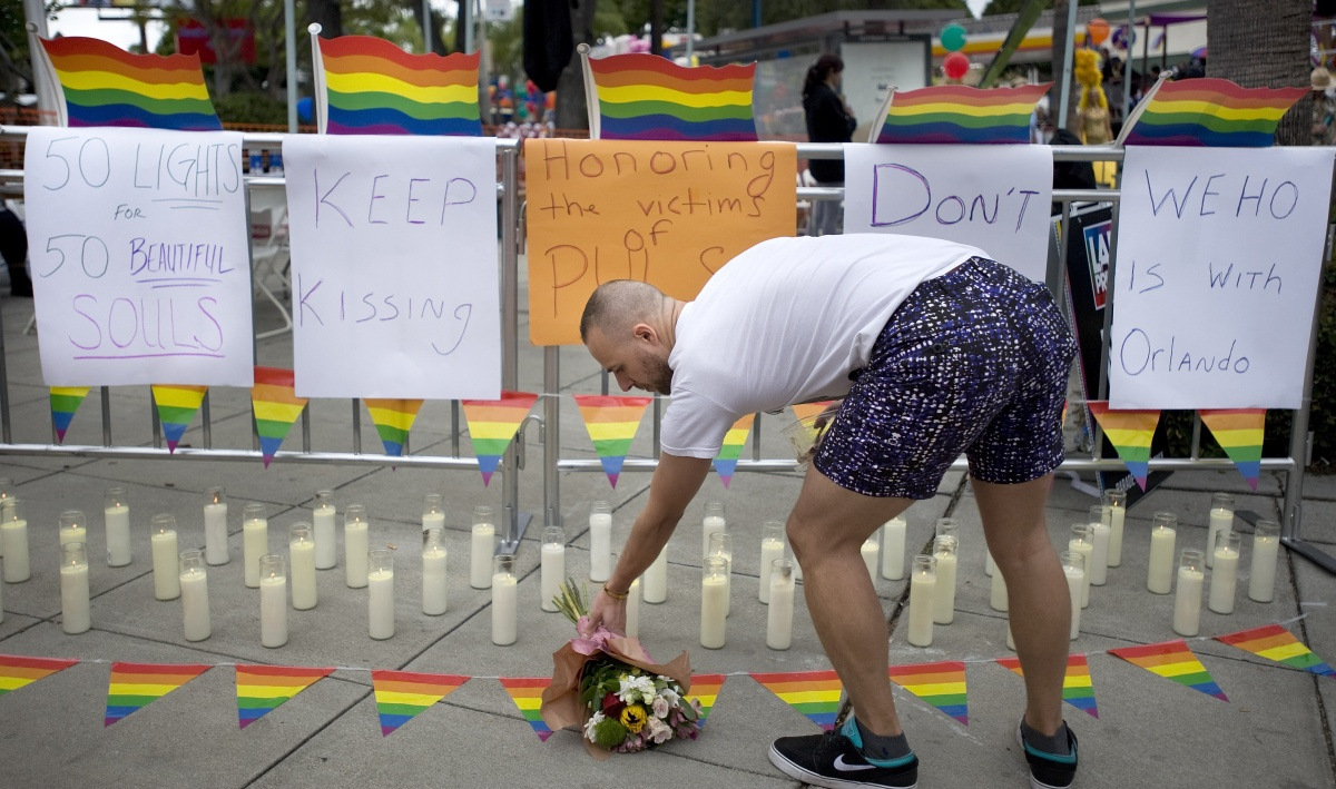 A memorial with 50 candles for at least 50 people gunned down at a gay nightclub in Orlando, Florida.f